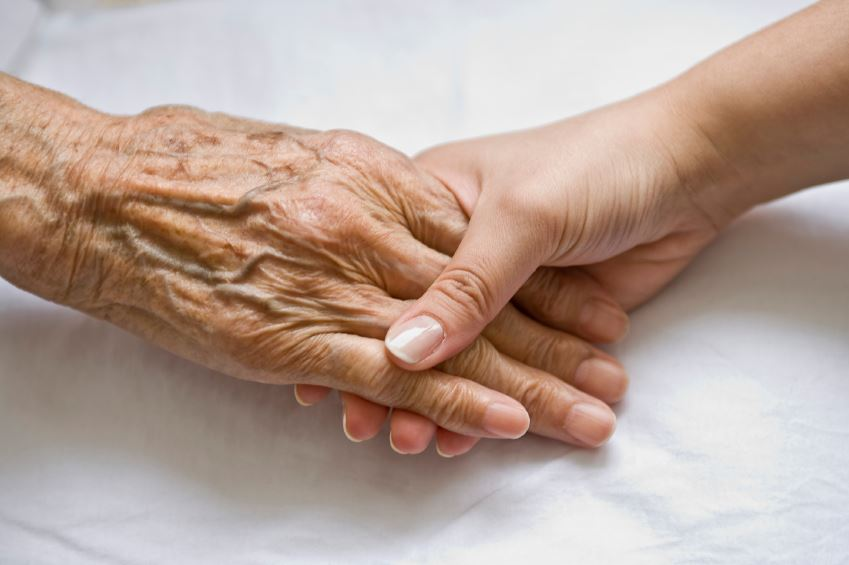 Elder Abuse (Old and Young Hands)